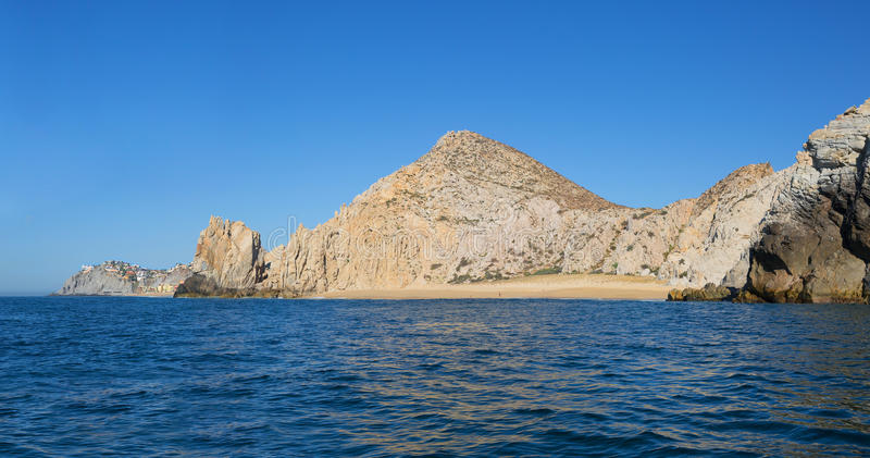 Secluded beach among the rocks in Cabo San Lucas (Mexico). The beach in Cabo San Lucas (Mexico) It's a wild, secluded beach with beautiful rocky coastline in stock images