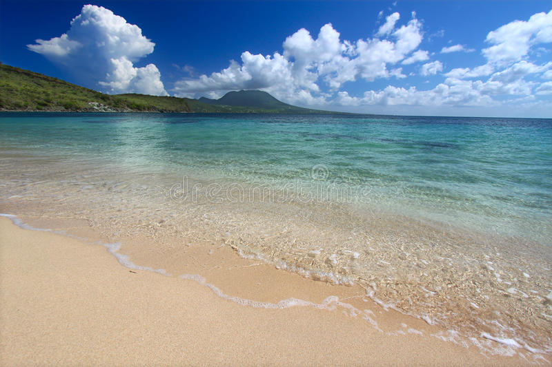 Secluded beach on Saint Kitts. A secluded beach on the Caribbean island of Saint Kitts stock photography