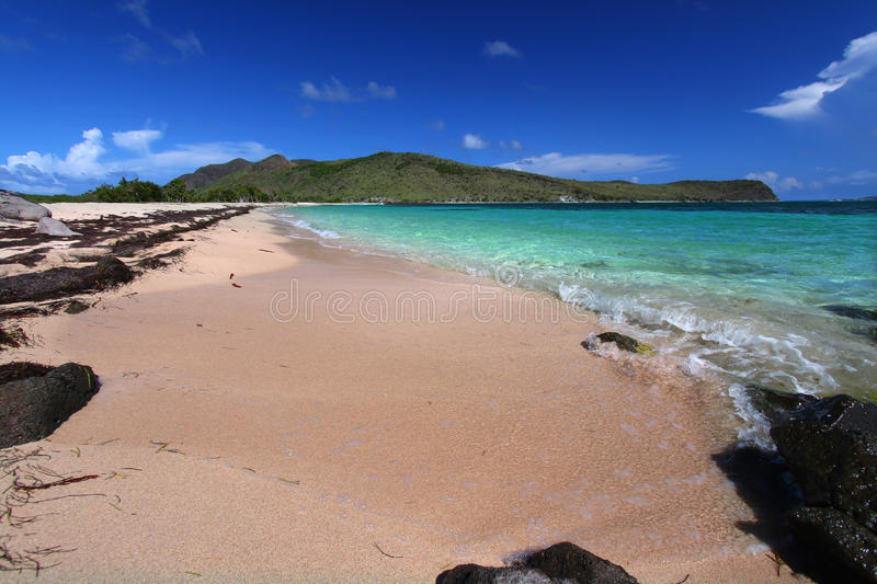 Secluded beach on Saint Kitts. A secluded beach on the Caribbean island of Saint Kitts royalty free stock photos