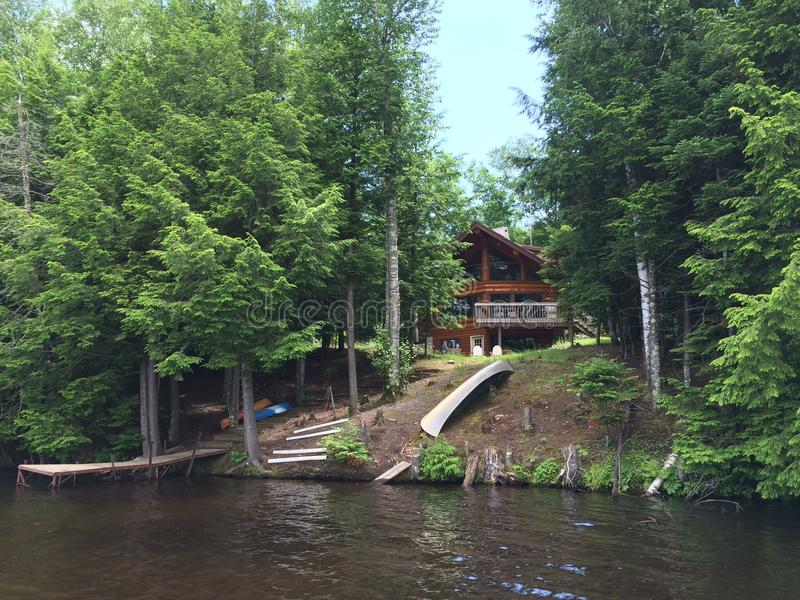 Secluded cabin on lake stock photography