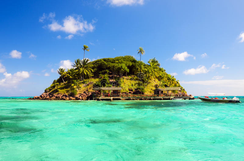 Secluded Tropical Island. Lush tropical island surrounded by beautiful turquoise Caribbean water stock photography