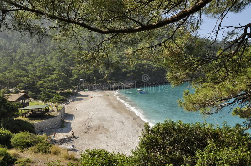 Secluded Turkish beach. Looking down on a secluded beach surrounded by forest in Fethiye, Turkey stock photos