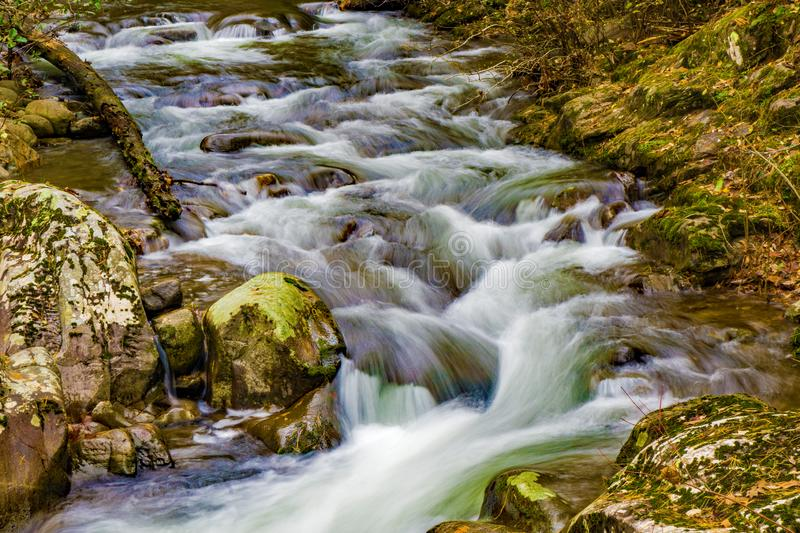 A Seclued Wild Mountain Trout Stream. An autumn view of a secluded wild mountain trout stream located in the Blue Ridge Mountains of Botetourt County of Virginia stock image
