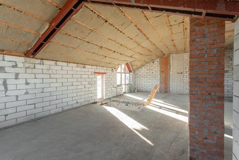 The second attic floor of the house. overhaul and reconstruction. Working process of warming inside part of roof. House. Or apartment is under construction stock images