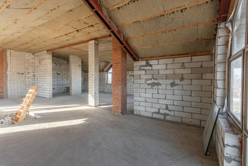 The second attic floor of the house. overhaul and reconstruction. Working process of warming inside part of roof. House. Or apartment is under construction stock image