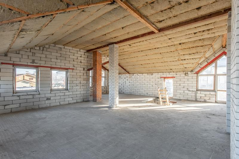 The second attic floor of the house. overhaul and reconstruction. Working process of warming inside part of roof. House. Or apartment is under construction royalty free stock photo