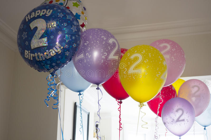 Second Birthday Balloons. A dozen multi-coloured 2nd birthday helium balloons royalty free stock photos