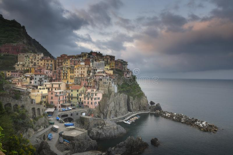Second city of the Cique Terre sequence of hill cities - Manarola. Colorful spring sunset in Liguria, Italy stock photography