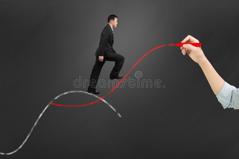 The second curve concepts. Woman hand holding chalk drawing two curves with businessman climbing stock photography