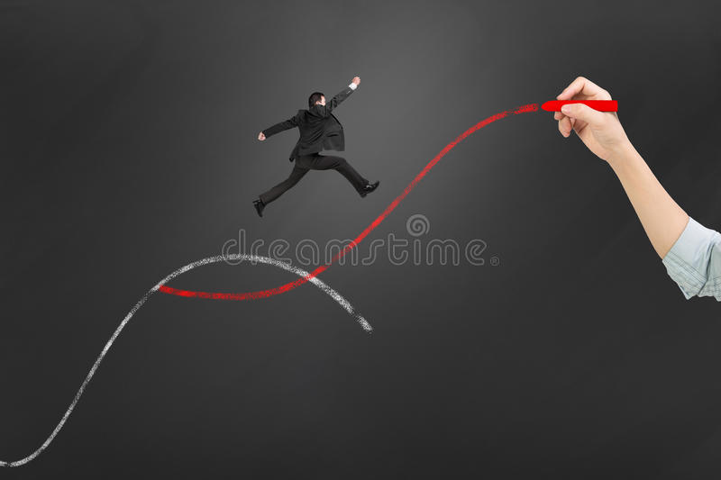 The second curve concepts. Woman hand holding chalk drawing two curves with businessman jumping royalty free stock images