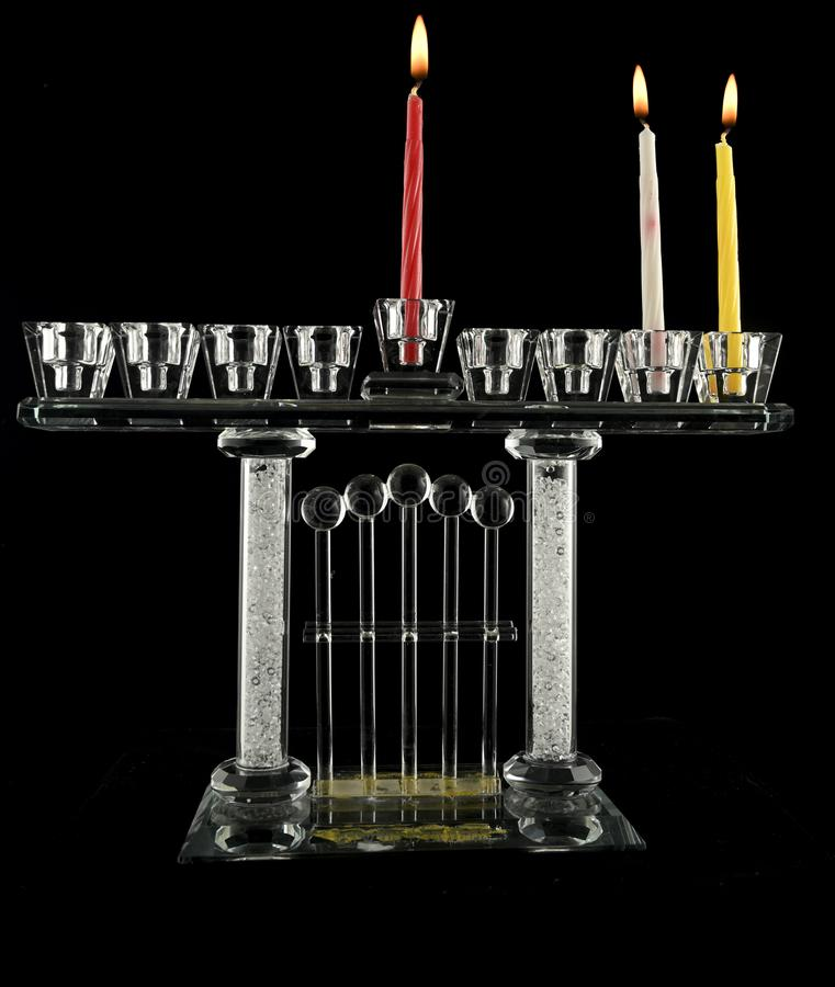 The second day Hanukkah menorah crystal lamp. The second, day Hanukkah menorah crystal lamp that is lit for eight days of Hanukkah on a black background royalty free stock images