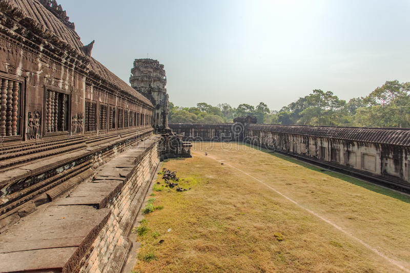 Second enclosure wall, Angkor Wat, Siem Reap, Cambodia. Tourists commonly take the picture of the reflection of Angkor Wat at the lake in front of Angkor stock photo