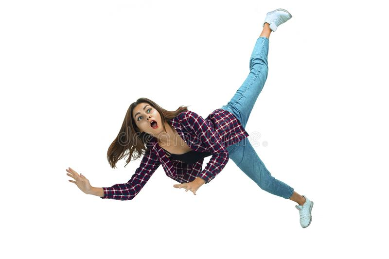 A second before falling - young girl falling down with bright emotions and expression royalty free stock image