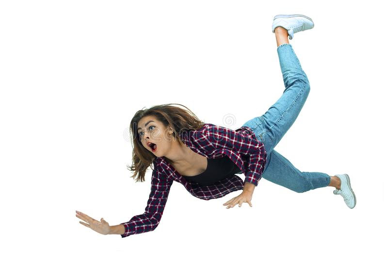 A second before falling - young girl falling down with bright emotions and expression stock photo