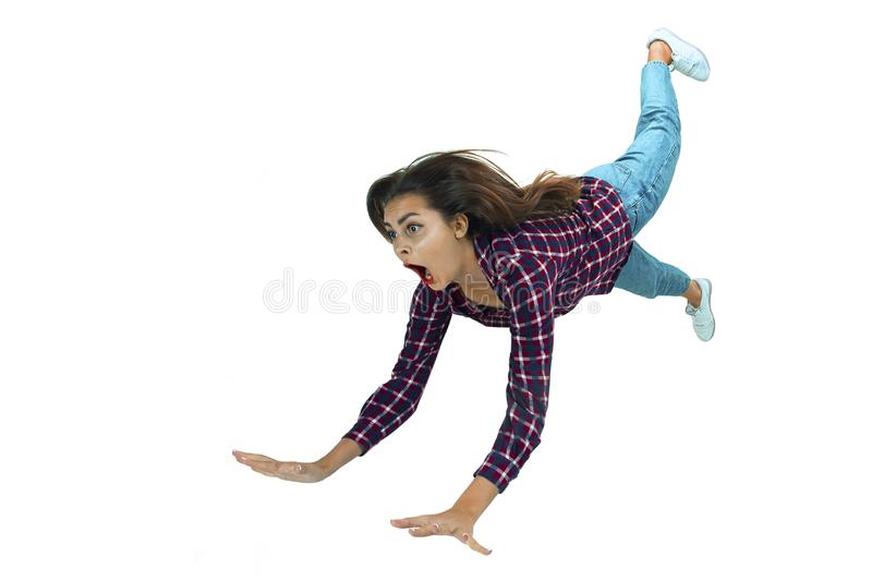 A second before falling - young girl falling down with bright emotions and expression royalty free stock images