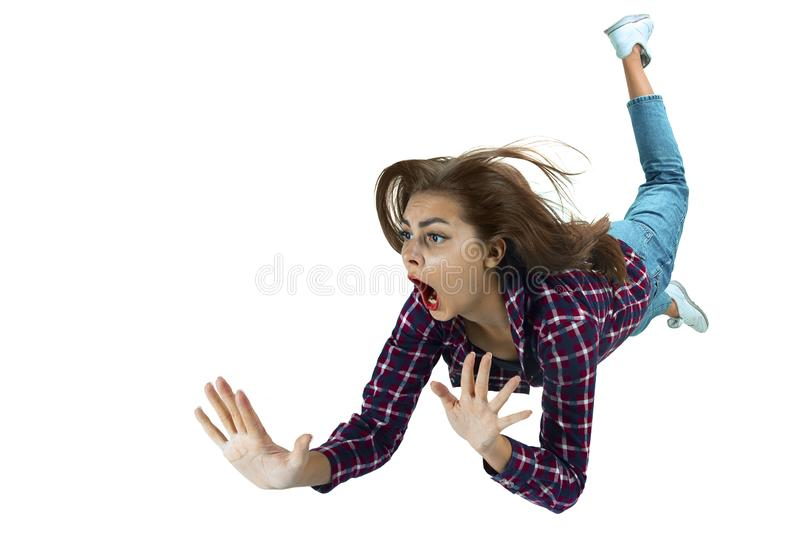 A second before falling - young girl falling down with bright emotions and expression royalty free stock photography