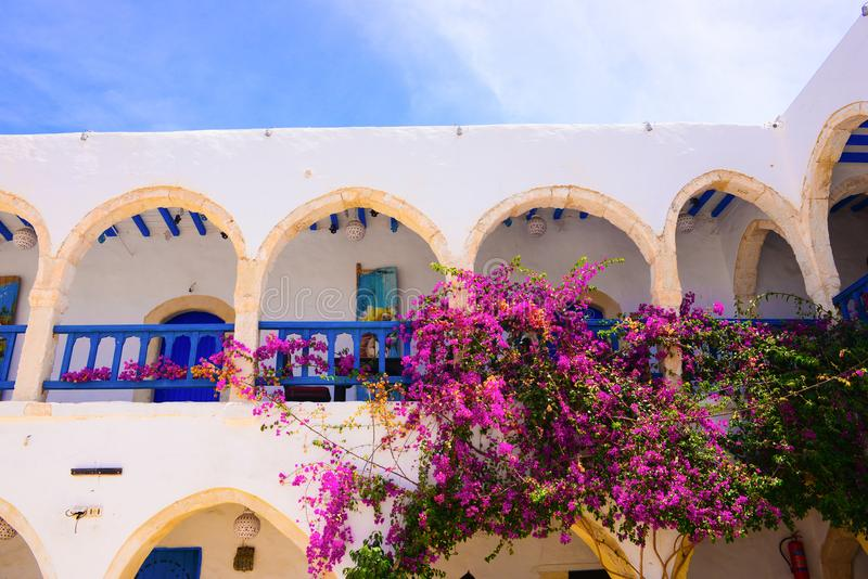 Tea House and Restaurant Terrace, Djerba Street Market, Tunisia. Second floor balcony and arched corridor from El Fondouk, a traditional and beautiful Tea House royalty free stock image