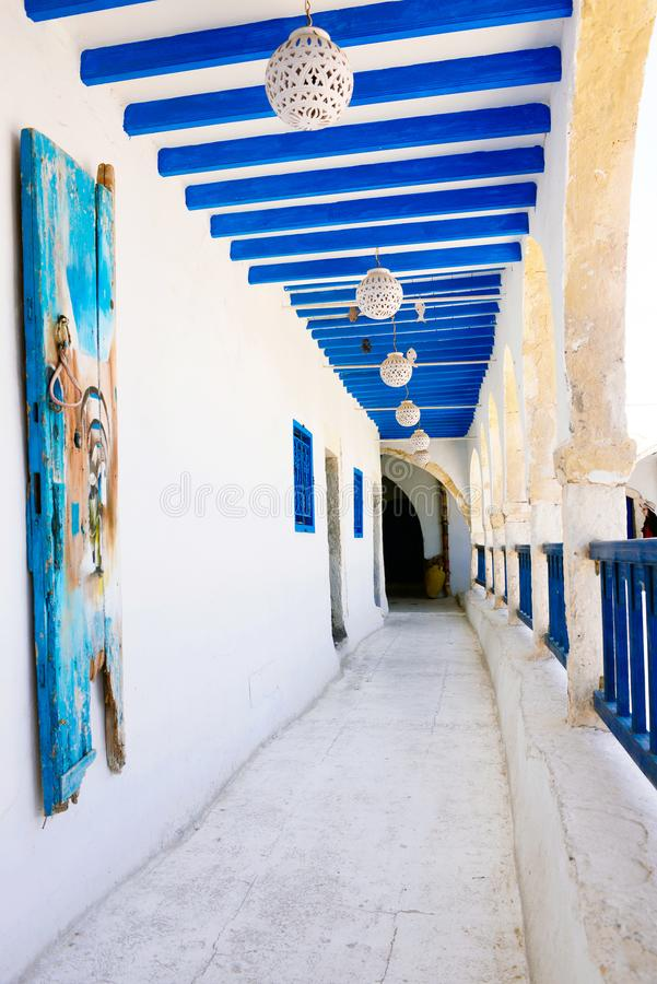 Picturesque Blue and White Balcony and Corridor - Djerba Street Market, Tunisia. Second floor balcony and corridor from El Fondouk, a traditional and beautiful royalty free stock image