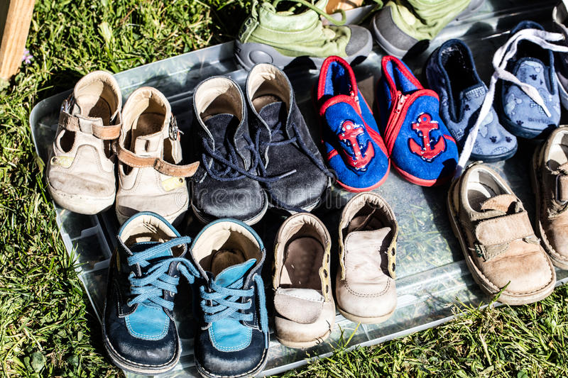 Second hand baby and child shoes for reusing or recycling royalty free stock photos