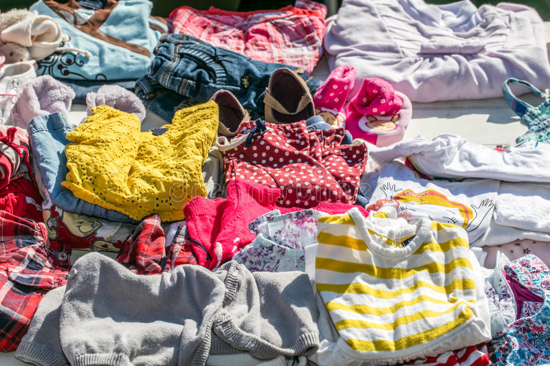 Second hand baby and children clothes for reusing or reselling. Display of second hand baby and children clothes for reusing, reselling,recycling,donating or royalty free stock image