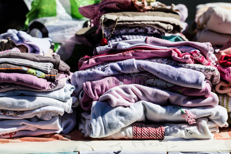 Second hand baby clothes and pyjamas for reusing or reselling. Display of second hand baby clothes and pyjamas for reusing, reselling,recycling,donating or stock photography
