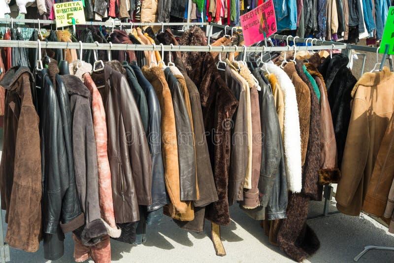 Second hand coats. On a street market royalty free stock photos