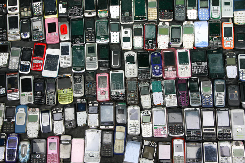 Second hand Feature Mobile Phone sale for spare part. Bangkok, Thailand - May 05, 2012: Second hand Vintage Feature Mobile Phone sale for spare part in Klong royalty free stock photo