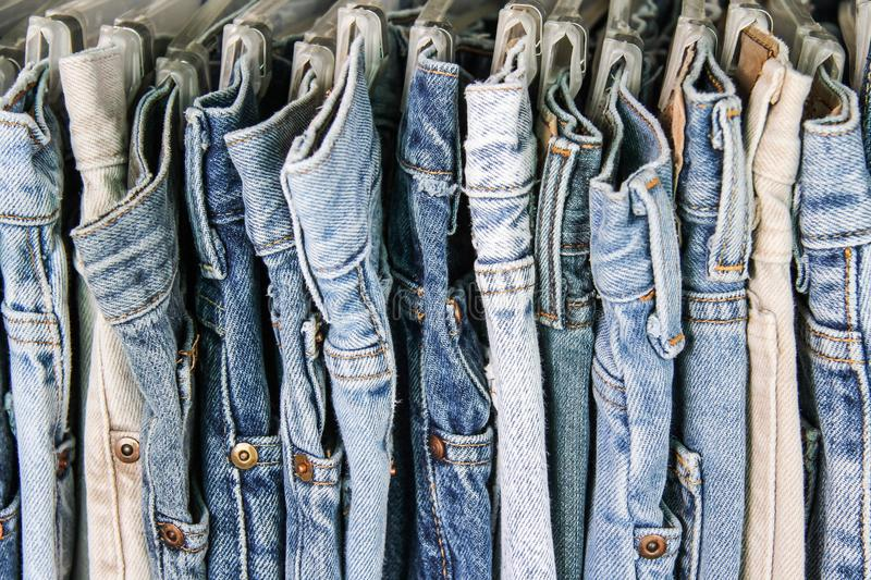 Second hand jeans on a rack. A rack of second hand jeans royalty free stock photo