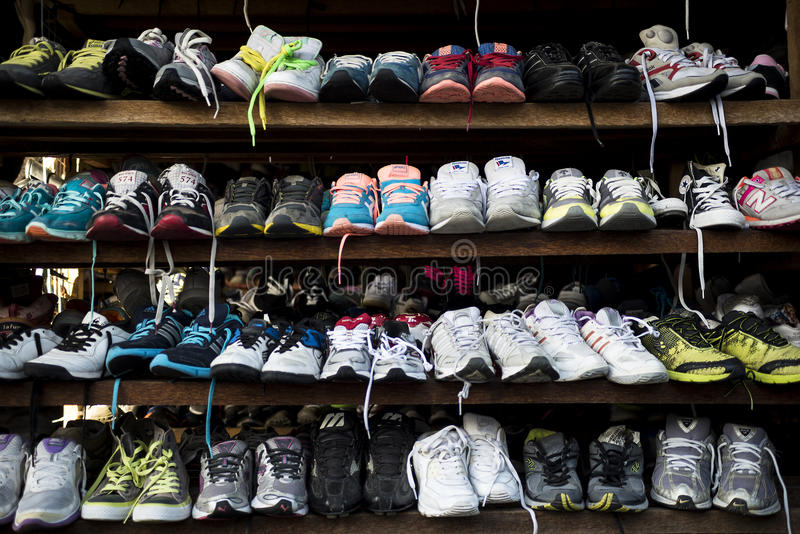Second hand shoes. Kalibo, Philippines - February 13, 2016. Second hand shoes on the shelf of a store royalty free stock photos