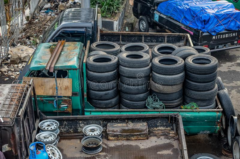 Sell tyres. Second hand tyres in street market royalty free stock photos