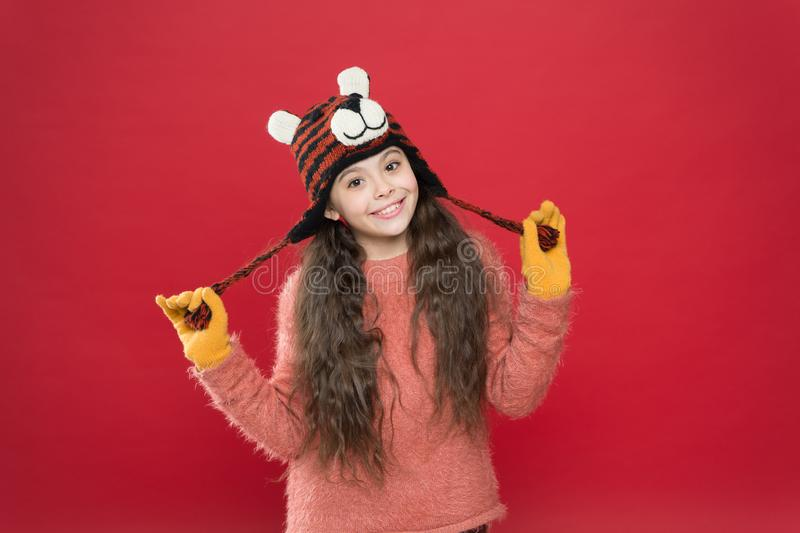 A second life for clothes. have fun on winter holiday. christmas time. fashion for kids. funny knitwear accessory. small. Happy girl in knitted hat. cheerful stock images