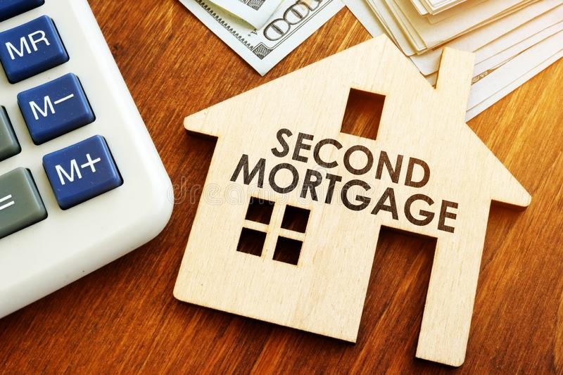 Second Mortgage written on model of home. Second Mortgage written on wooden home stock photography