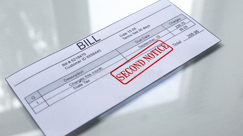 Second notice seal stamped on bill, payment for services, month expenses tariff. Stock photo royalty free illustration