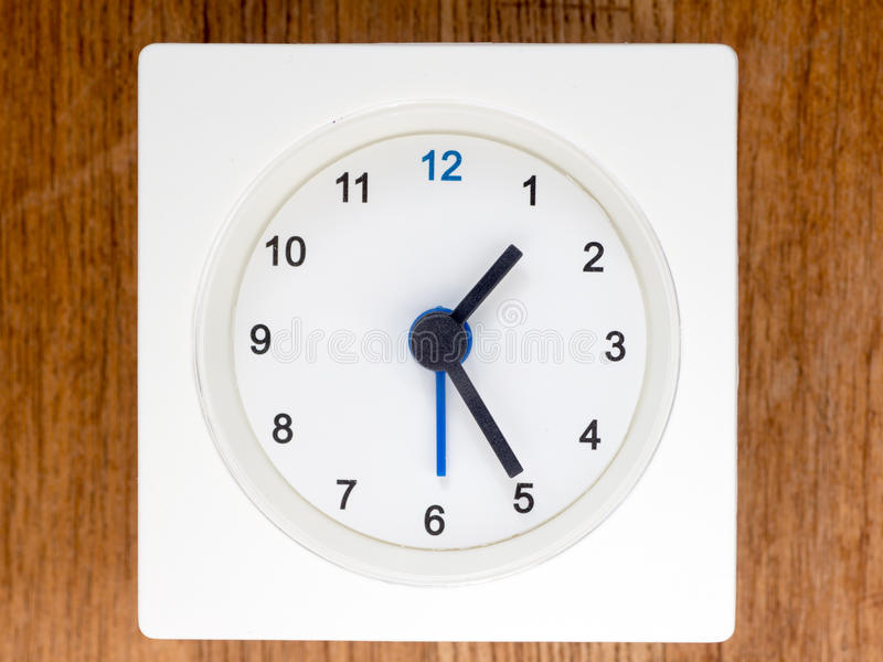 The second series of the sequence of time, 12/96. The second series of the sequence of time on the simple white analog clock , 12/96 royalty free stock photo
