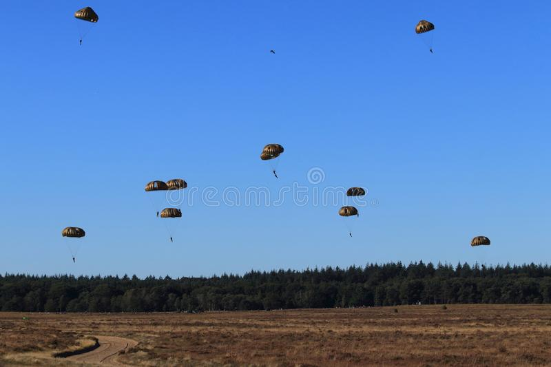 Second world war mass dropping paratroopers stock photos