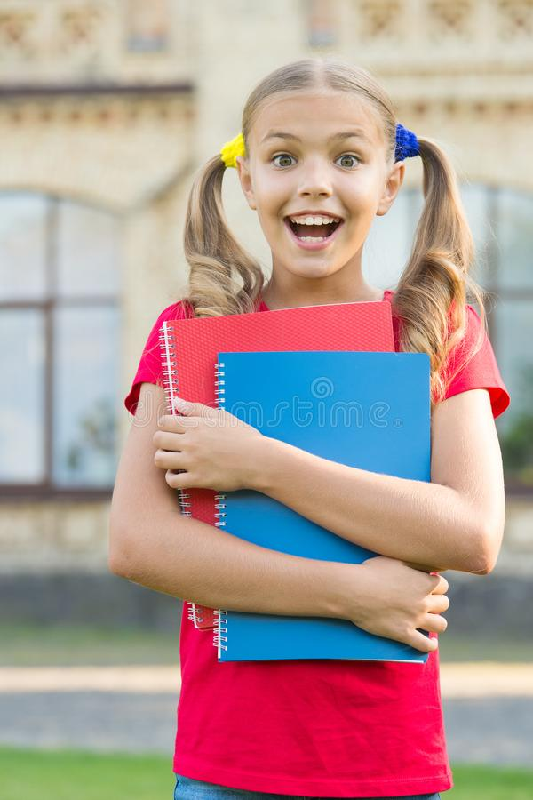 Secondary school student. Study language. School education concept. Cute little bookworm. Cute smiling small child hold stock photos