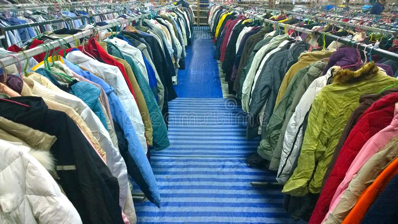The Secondhand clothes in the market. Secondhand clothes in the market stock photography