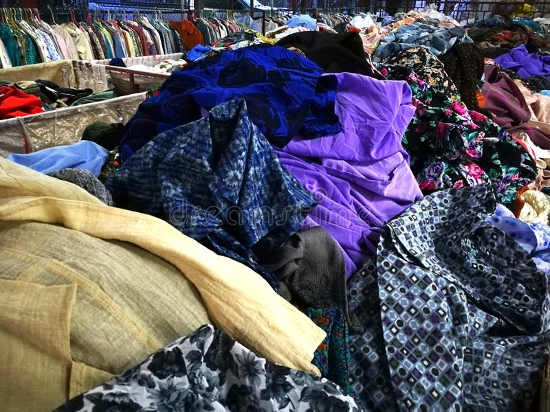 The Secondhand clothes in the market. Secondhand clothes in the market stock images