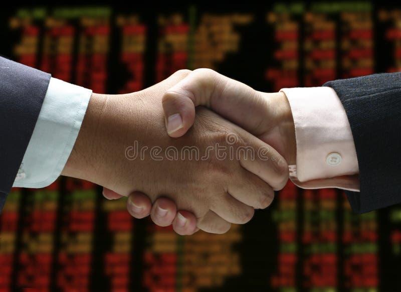 Secousse de main à l'indice des actions image stock
