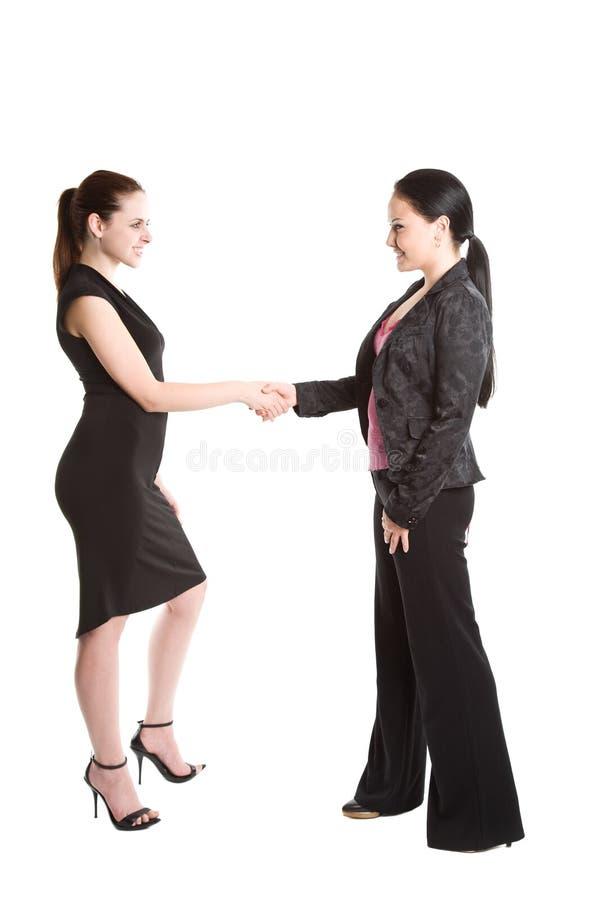 secousse de mains de femmes d'affaires photo stock