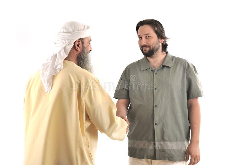 Secousse musulmane arabe d'homme d'affaires photo stock