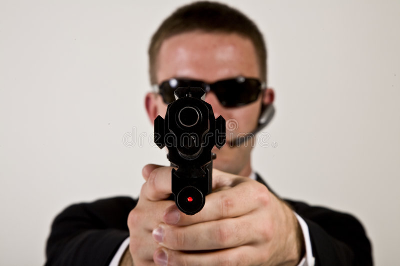 Download Secret Agent Pointing A Gun Stock Image - Image: 5806835