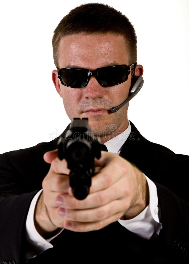 Secret Agent Pointing a Gun stock image