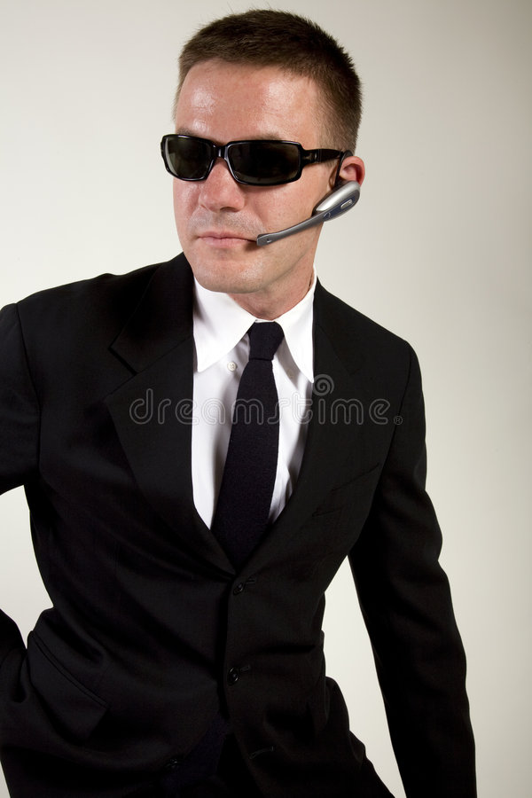 Secret Agent Reaches for Gun royalty free stock image