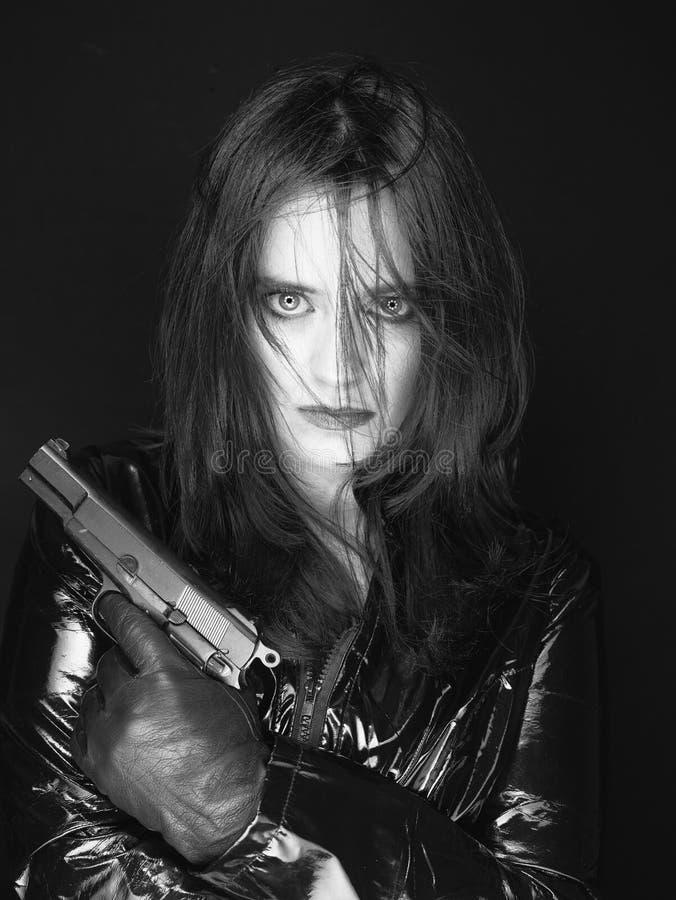 Secret agent woman with gun stock image
