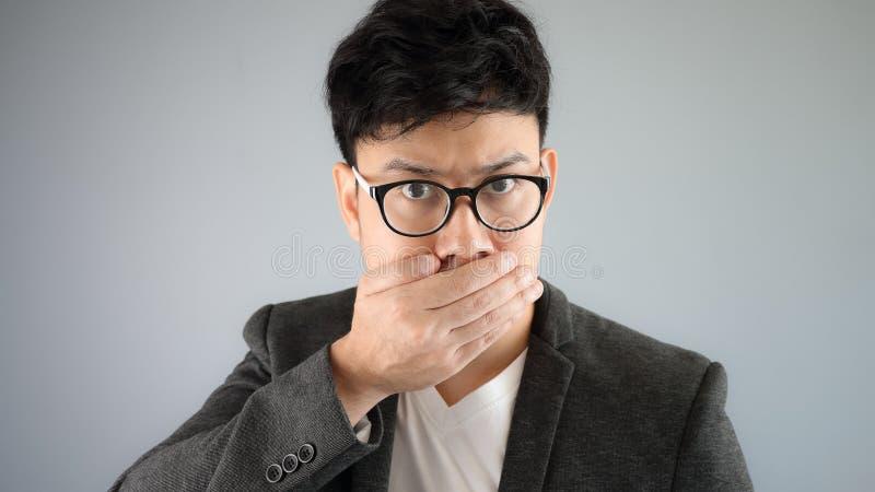 Secret of Asian man business. royalty free stock photo