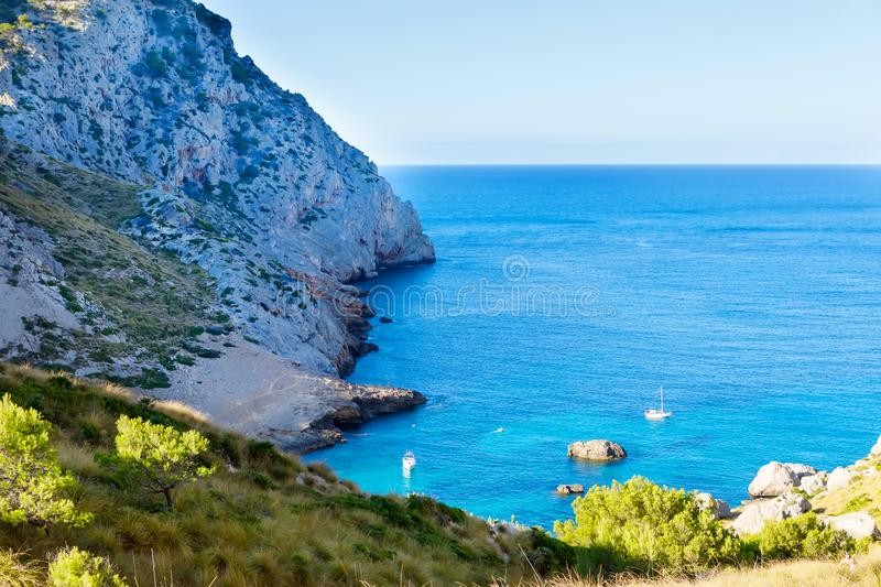 Secret beach - wild coast of Mallorca, Spain, Balearic Islands. Artistic sunrise and dusk landascape. Secret lonely beach bay - wild coast of Mallorca, Spain royalty free stock photos