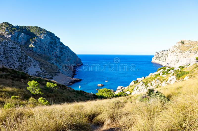 Secret beach - wild coast of Mallorca, Spain, Balearic Islands. Artistic sunrise and dusk landascape. Secret lonely beach bay - wild coast of Mallorca, Spain royalty free stock images