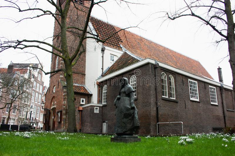 Secret garden of the beghine of amsterdam. statue in the middle of the green in the reserved and silent neighborhood inhabited by royalty free stock photos