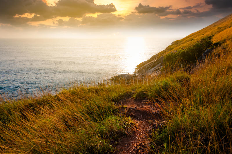 A secret pathway to beautiful scenic unknown cliff during sunset stock images